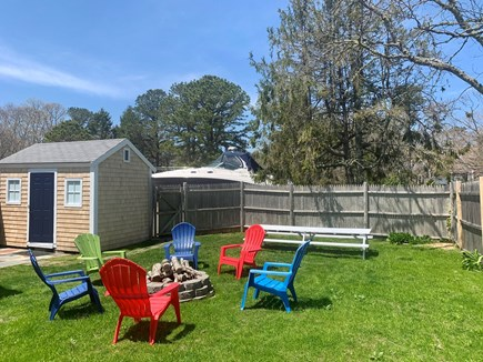 Harwich Port  Cape Cod vacation rental - Private fenced back yard with fire-pit, picnic table and grill.