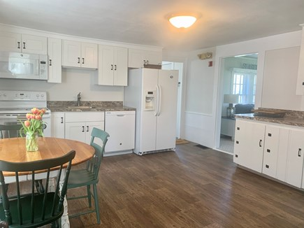 Harwich Port  Cape Cod vacation rental - Open bright kitchen area with cozy dining area.