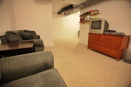 Wellfleet Cape Cod vacation rental - Downstairs TV Area with Chair Sofa Beds