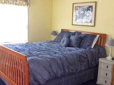 East Sandwich Cape Cod vacation rental - Large master bedroom with queen, bureaus, TV/DVD,  closet, chairs