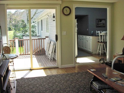 East Sandwich Cape Cod vacation rental - View from family room to deck and kitchen/dining area