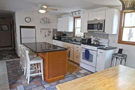 Eastham Cape Cod vacation rental - Well Lit open Kitchen with Island and ceiling fan.