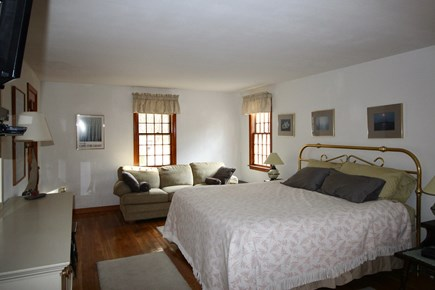 Truro Cape Cod vacation rental - Main Bedroom with Couch and flat screen TV