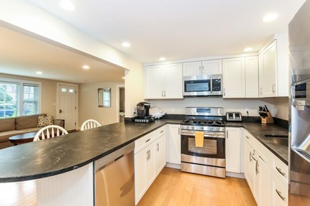 Mashpee, Popponesset Cape Cod vacation rental - Modern kitchen, granite countertops with high end appliances.