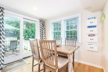 Mashpee, Popponesset Cape Cod vacation rental - Dining area with sliders to the back deck.