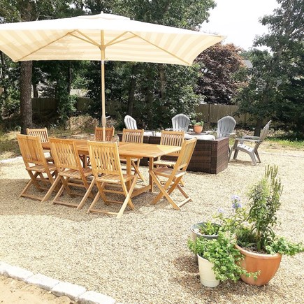 Harwich, Red River Beach Cape Cod vacation rental - Patio / Firepit Instagram:  @thebluedoor_harwich