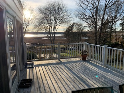 Marion MA vacation rental - Large deck overlooking back yard and Aucoot Cove