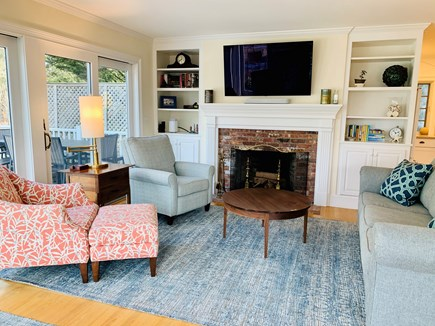Marion MA vacation rental - Living room with custom built-ins, large cable TV and Sonos.