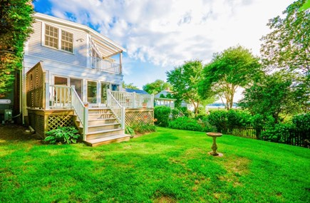 Marion MA vacation rental - Back yard with decks overlooking Aucoot Cove with ample seating.