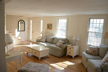 Chatham Cape Cod vacation rental - Sunny living room with fireplace and large selection of games