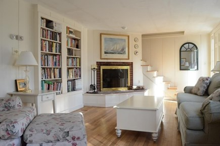 Chatham Cape Cod vacation rental - Living room with fireplace and well-stocked built-in bookshelves