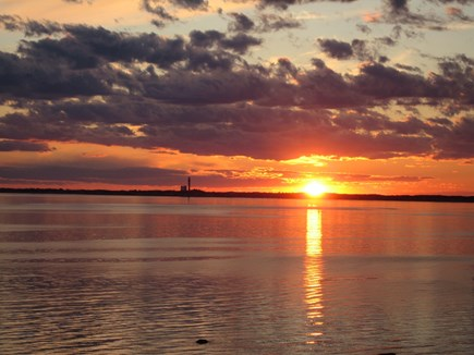 North Truro Cape Cod vacation rental - Sunset over Provincetown from deck.
