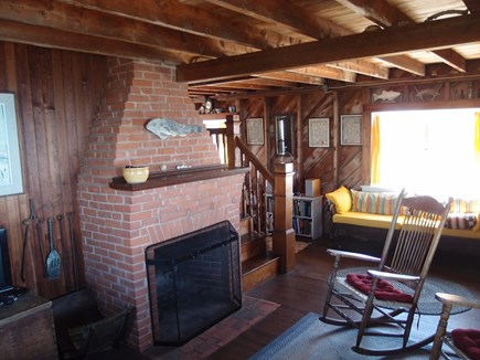 North Truro Cape Cod vacation rental - Living room with fireplace.