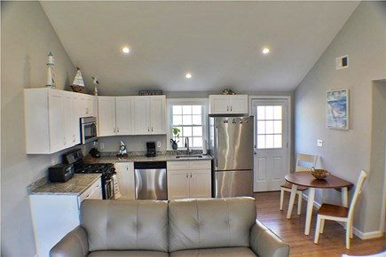 Yarmouth, Lewis Bay Cape Cod vacation rental - View of kitchen and dining room from living room