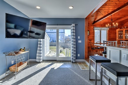 Sandwich Cape Cod vacation rental - Den features TV and slider to back yard area.