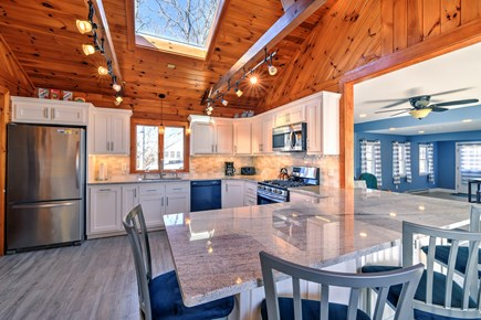 Sandwich Cape Cod vacation rental - Kitchen features counter top bar.