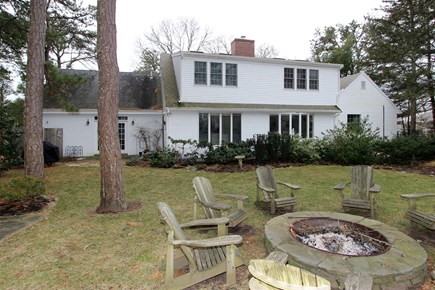 Brewster Cape Cod vacation rental - Spacious back yard with a fire pit