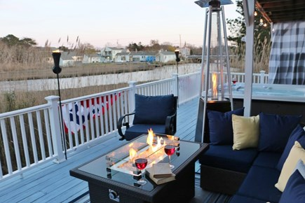Dennis Cape Cod vacation rental - Fire Pit overlooking the water.   Seating for 8