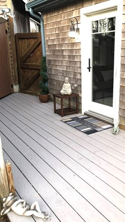 Eastham Cape Cod vacation rental - Privt yard on left. Photo of T/Chairs, umbrella, grill,to come