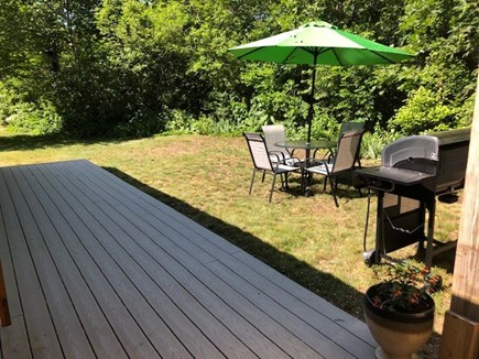 Eastham Cape Cod vacation rental - Private yard and deck with seating and new grill.