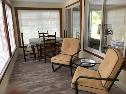Bayside in East Dennis Cape Cod vacation rental - Screen porch with table, chairs and sitting area