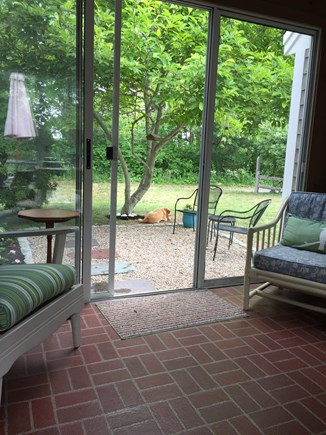 Quivet Neck, East Dennis Cape Cod vacation rental - Sliders from breezeway to patio in front yard