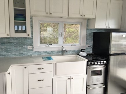 Wellfleet Oceanfront Home Cape Cod vacation rental - Kitchen with New Cabinets, tile & stainless steel appliances