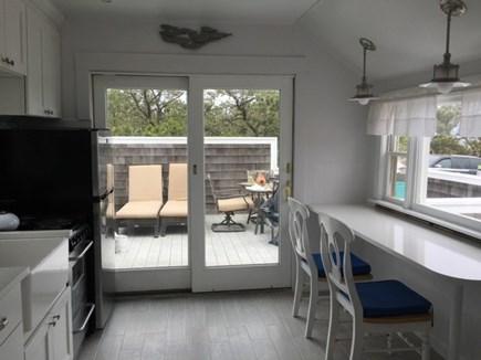 Wellfleet Oceanfront Home Cape Cod vacation rental - Kitchen w Picture window to Ocean, & French Door to Dining Deck