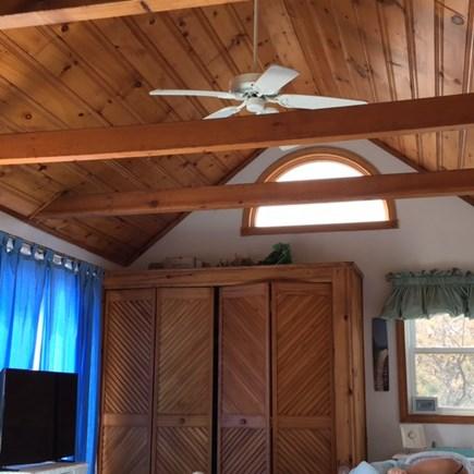 Wellfleet Oceanfront Home Cape Cod vacation rental - Master Bedroom, warm wood, beams, ceiling fan