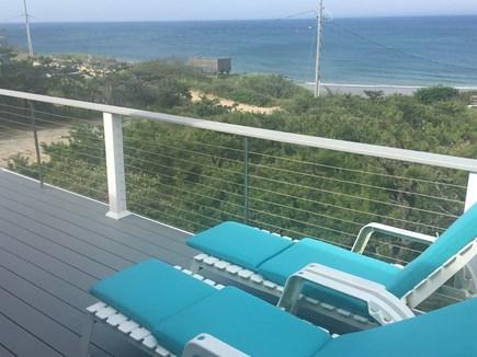 Wellfleet Oceanfront Home Cape Cod vacation rental - Master BR Deck w Lounges overlooking Ocean