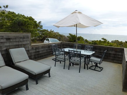 Wellfleet Oceanfront Home Cape Cod vacation rental - Lower deck lounges New Dining Table seats 8