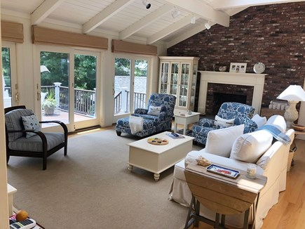 New Seabury New Seabury vacation rental - Living Room. Sliding doors open up to patio and waterfront views.
