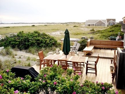 North Truro Cape Cod vacation rental - View of the deck in the direction of Provincetown.