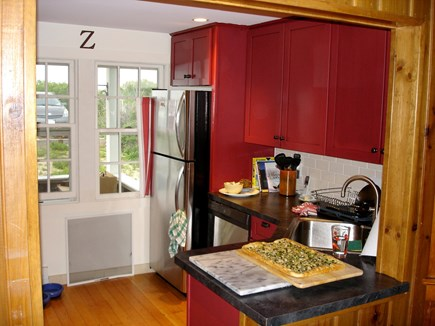 North Truro Cape Cod vacation rental - Kitchen that opens to the dining room.