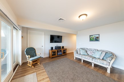 Mashpee, Popponesset Cape Cod vacation rental - Lower lever entertainment area with pull-out couch
