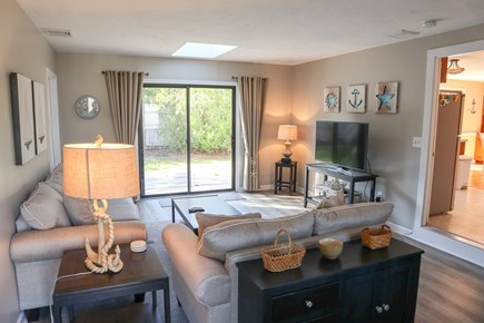 Chatham Cape Cod vacation rental - LR/TV lounge walks out to deck