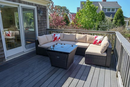 Chatham Cape Cod vacation rental - Great deck space with a fire table.