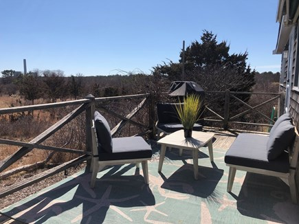 Sagamore Beach Cape Cod vacation rental - Cozy side deck with marsh view. Gather with family and friends!