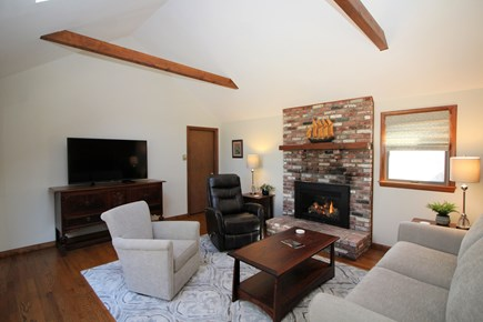 Truro Cape Cod vacation rental - Comfortable living room with vaulted ceiling, gas fireplace & TV