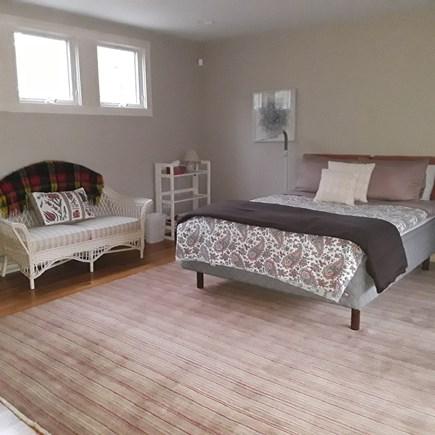 Wellfleet Cape Cod vacation rental - Bedroom with screened in porch and shower bath. Door to patio too