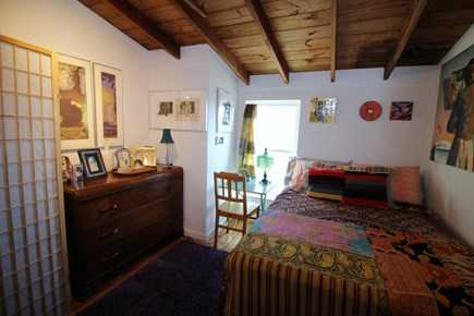 Wellfleet Cape Cod vacation rental - Bedroom with queen bed and washer/dryer behind screen
