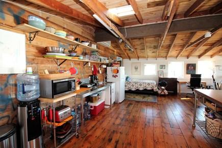 Wellfleet Cape Cod vacation rental - Queen bed is tucked in corner by kitchen area