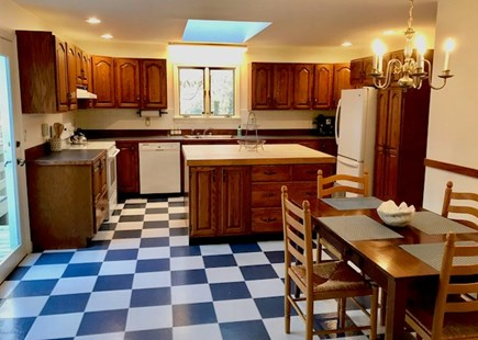 Orleans Cape Cod vacation rental - Spacious eat-in kitchen with island and slider to deck