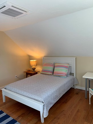 Chatham Cape Cod vacation rental - Upstairs queen bed in bedroom with another tv.