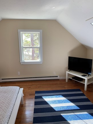 Chatham Cape Cod vacation rental - Television in upstairs bedroom with queen bed.