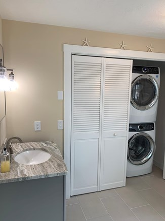Chatham Cape Cod vacation rental - New washer and dryer in cabinet in the downstairs bathroom.