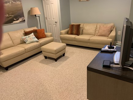 Falmouth Cape Cod vacation rental - Basement sitting room with 2 full sofas and tv