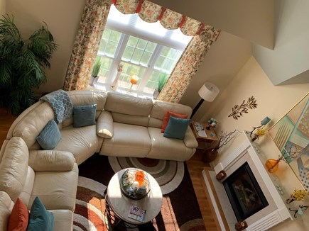 Falmouth Cape Cod vacation rental - Cozy and inviting family room with gas fireplace and 65 inch tv