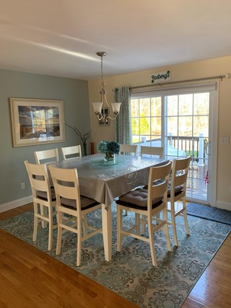 Falmouth Cape Cod vacation rental - Kitchen dining with sliders to deck, patio and hot tub