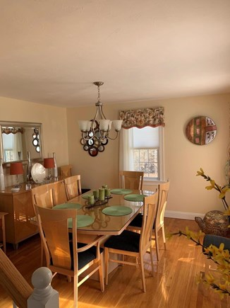 Falmouth Cape Cod vacation rental - Bright and sunny dining room with seating for 8.